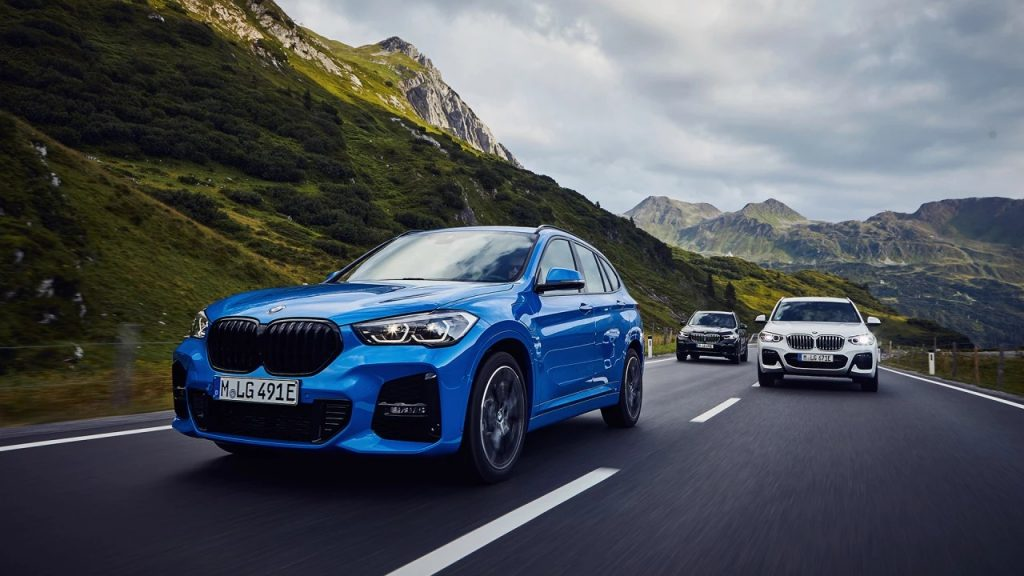 Image of BMW X Models driving through mountains